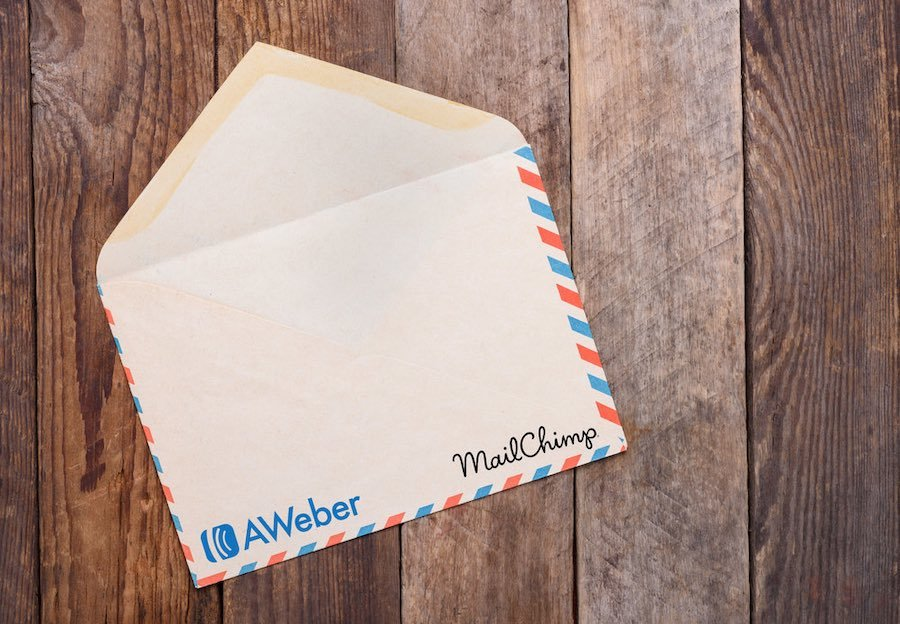 Mailchimp vs Aweber comparison (image of an envelope showing both products' logos).