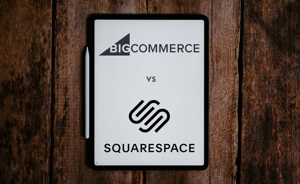 Bigcommerce vs Squarespace - the two logos on different sides of a notebook