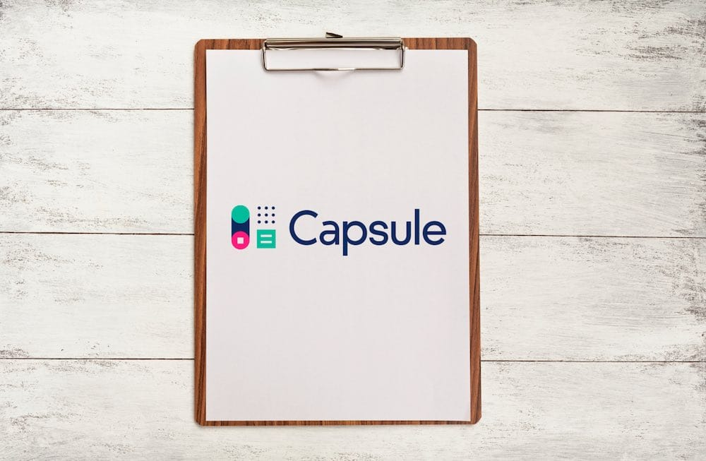 Capsule CRM review (image of the product logo on a clipboard)