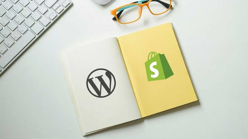 Shopify vs WordPress comparison. Image featuring the WordPress and Shopify logos in a notepad.