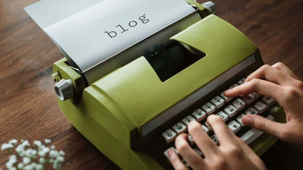 Increase blog traffic — image of a blogger typing