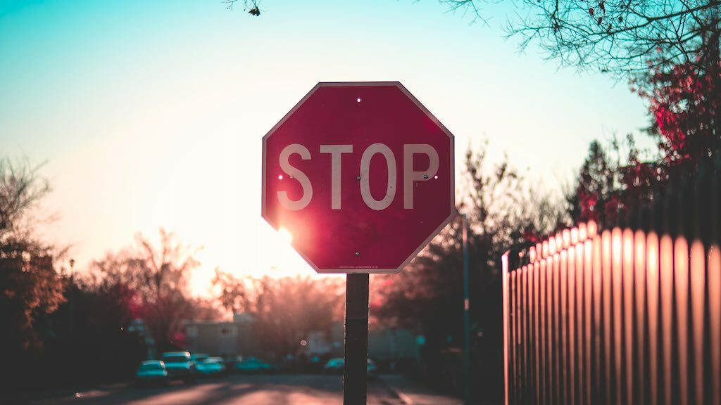 Image of a stop sign, accompanying some information about being aware to the threat of cyber fraud.