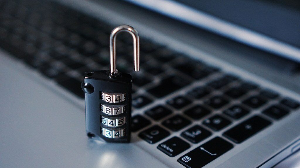 Cyber security tips — image of a computer and a padlock