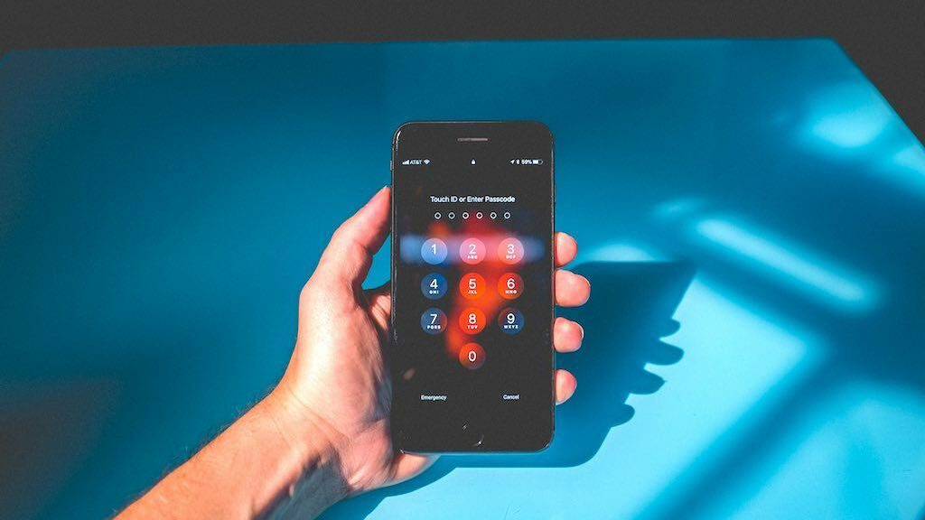 Password protection on a smartphone — creating strong, unique passwords is one of our key cyber security tips.
